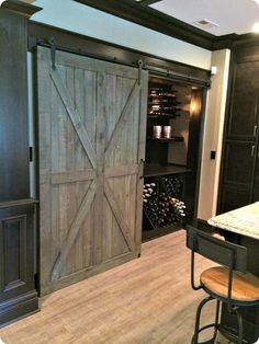OBSESSED with this old barn door! This is the dream! http://www.oldtimepottery.com/