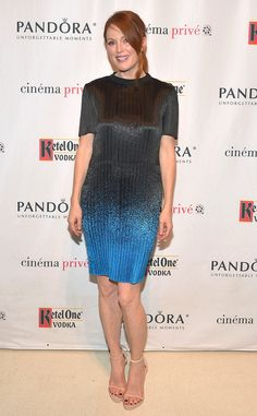 Shying away from her usual all-black outfits, Julianne stuns in a molten gray and blue ombré sheath at the Still Alice screening in LA.