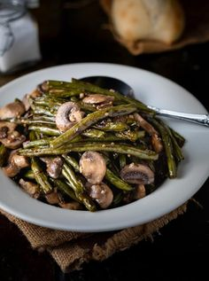 These Roasted Green Beans are tossed in olive oil, sprinkled with sea salt and freshly cracked pepper, and topped with an easy mushroom garlic butter sauce! Twice Baked Potatoes Casserole, Creamy Mashed Potatoes, Low Carb Side Dishes, Side Dishes Easy, Side Dish Recipes, Vegetable Recipes, Chicken Bacon Spinach Pasta, Oven Roasted Green Beans, Butter Sauce