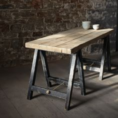 LOMWE TRESTLE TABLE The Lomwe Trestle table is handmade from reclaimed boards and completed with distressed black legs.  The piece is available with or without a bottom shelf.    Each one is skilfully created in Devon by our resident carpenter.  Paints used are water based.  Distressed Black