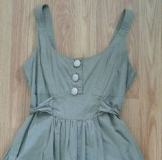 """Green Summer Dress Empire waist and tied in the back. One button is missing. Has pockets!!  Length is 33"""" and waist is 15"""" and cinches way smaller Dresses"""