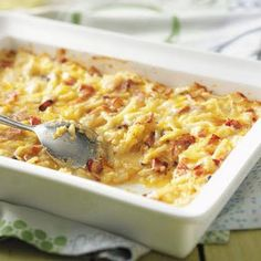 Amish Breakfast Casserole Recipe....  with Bacon, Sweet Onion, Eggs, Frozen Hash Brown Potatoes, Cheese, Cottage Cheese, & Swiss Cheese...