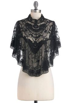 Photographic Flashback Cape. Paging through small, faded childhood photographs of your great-grandmother, you feel a strong sense of connection to her elegant style in the high neck and tri-buttoned keyhole closure of this intricate ink-black cape you've hung over the shoulders of your simple chiffon maxi dress. #black #wedding #modcloth