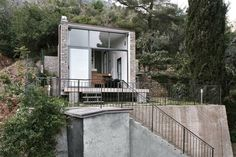 shipping container home with stone facade