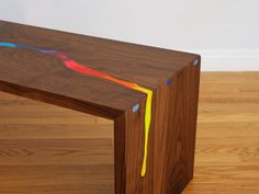 Wooden Table Has a Rainbow River of Melted Crayons Flowing Through It