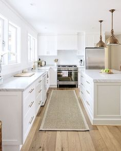 Sisal runner, white kitchen with carrara marble, brass accents, oak floors, shiplap walls by Cottonwood Interiors | Interior design, styling & photo by @cottonwoodinteriors