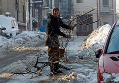 A woman carries firewood in Bucharest on January 31, 2012.