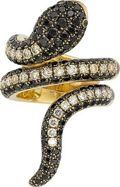 The ring features full-cut black diamonds weighing a total of approximately 1.60 carats, enhanced by full-cut diamonds weighing a total of approximately 1.00 carat, accented by round-cut demantoid garnets, set in 18k gold, marked Siera (black diamonds not tested for origin of color). Gross weight 19.70 grams. Size: 5-3/4 (not sizeable) Estimate: $4,000 - $6,000.