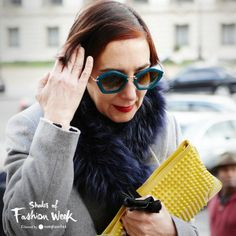 Love how the shades add a pop up color to this immaculate coat. At the Paris Fashion Week. #pfw #shadesoffashionweek #sunglasses