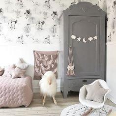 grey and pink nursery decor | wardrobe in baby's room