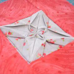 http://mypatchwork.wordpress.com/2012/11/17/block-24-fabric-origami-textured-quilt-sampler/