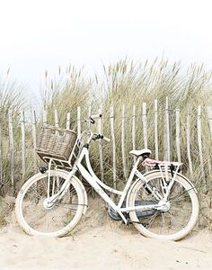 white vintage bike at the beach                                                                                                                                                                                 More