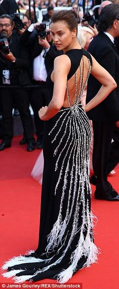 A web of intrigue: Russian model Irina Shayk looked elegant in a black gown with spider-es...