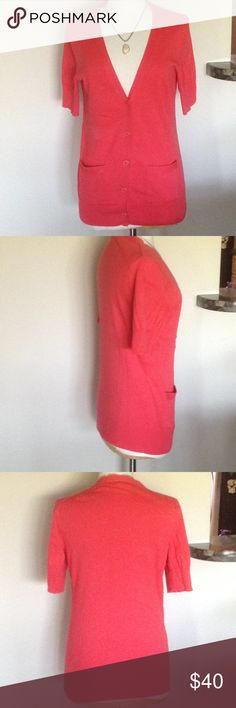 Lilly Pulitzer short sleeve cardigan in salmon  S Soft short sleeve Lilly Pulitzer lightweight cardigan in a pretty salmon color. Size Small.  Front pockets, 5 buttons and decorative knit on sleeves and bottom are beautiful finishing touches.  85% cotton and 15% silk. Hand wash or dry clean. Lilly Pulitzer Sweaters Cardigans