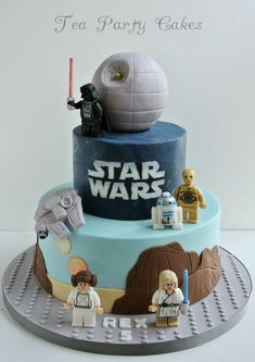 6 and 10 inch fondant covered cakes with fondant figures with hand painted details. The Death Star is a styro ball covered in fondant and the light sabers are lollipop stick that were cut down to size and covered with some lustre dust. TFL!