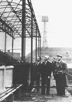 Leeds United officials survey the damage of the fire at Elland Road in the mid-fifties.
