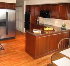 A great kitchen remodeling solution is cabinet refacing. Quality cabinet refinishing can change your out-of-date cabinets into designer cabinets for a fraction of the cost of new. A great alternative to new kitchen cabinets is refacing your existing cabinets saving you thousands of dollars. Done by Hometech Renovations