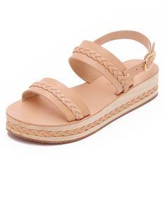 Braided leather trims the wooden platform on these smooth leather Ancient Greek Sandals. Buckle closure. Crepe sole. <ul> <li>Leather: Cowhide.</li> <li>Made in Greece.</li> <li>Measurements</li> <li>Heel: 1.5in / 35mm</li> <li>Platform: 1in / 25mm</li> </ul>