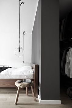 gray wall, lovely hanging lamps, and natural wood