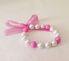 A personal favorite from my Etsy shop https://www.etsy.com/listing/182420039/stretch-pink-pearl-kid-bracelet-little