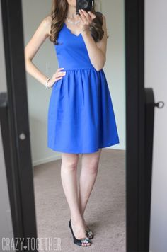 Dear Stylist, Love the scallop neckline of this dress and they way it flows off the hips. Love the color too!