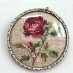 Pink Rose Cross Stitch Embroidery Round Framed Domed Glass Home Rose Decor by NellysLittleGifts on Etsy https://www.etsy.com/listing/227523318/pink-rose-cross-stitch-embroidery-round