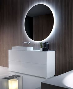 The modern bathroom has a new breath. PURE H 76 cm floor unit with double drawer in gloss White lacquered finish, with bevelled top in Cristalplant, on-top washbasin in Ceramilux SSL and straight edges round mirror with LED lighting. Follow Falper on it.pinterest.com/falperdesign