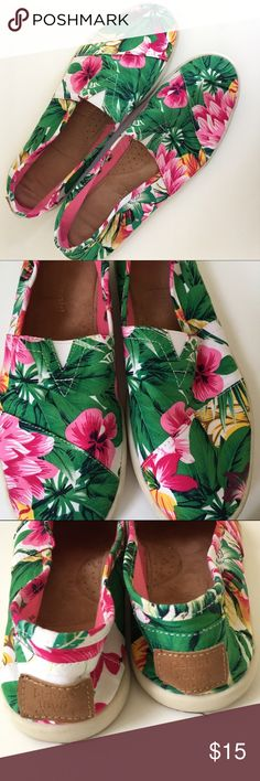 Toms style tropical print slip on sneakers The most fun print! Perfect when you're dreaming of summer :) vibrant tropical print with greens, pink and yellow. Slip on comfy canvas sneaker in great condition! Barely worn. Too tight for me so I only wore once or twice. Size 8.5 Madden Girl. Logo in leather on heel of shoes. So cute with shorts and a tank in the summer or white jeans and a tee in the spring. Madden Girl Shoes Sneakers