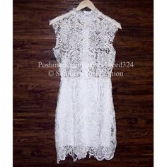 LACE DRESS Eyelet Sleeveless Wedding Cocktail Mini Size Medium. New With Tags. $85 Retail + Tax.   Lace dress with raw seams & semi sheer skirt underlay.  High neck with zip closure at back. Recommend to pair with a white bralette underneath as top is sheer.   Polyester. Imported.   ❗️ Please - no trades, PP, holds, or Modeling.    Bundle 2+ items for a 20% discount!    Stop by my closet for even more items from this brand!  ✔️ Items are priced to sell, however reasonable offers will be…