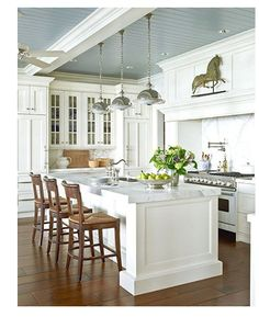 I love the white kitchen and the paintable wallpaper on ceiling that looks like beadboard planks