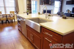 Sleek stainless steel apron front sink on our Titusville RTA Shaker Maple Brandywine cabinets