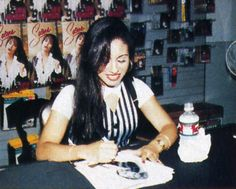 Selena signing autographs  1994