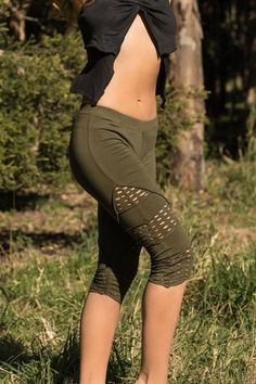 Olive Green Leggings is great for yoga, the festivals and the dance floor And for everyday wear. Wear it with one of our pixie tops and boots or sandals. #Leggings #Greenleggings #FestivalLeggings #Yoga #yogaleggings #Capri #FrillyLace #Steampunk #PixiePants #Yogapant #festival #olivegreen #oliveleggings