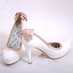 White shoes with pink trim