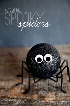 Create spooky Halloween spiders for decor using thrifted glitter ornaments!