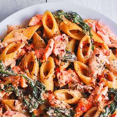 Salmon Pasta with Sun-Dried Tomato Cream Sauce and Spinach - quick and easy dinner made in 30 minutes! Pan-seared salmon is combined with the delicious penne in a flavorful, restaurant-quality cream sauce. Salmon is a Salmon Pasta Recipes, Creamy Salmon Pasta, Pasta Dinner Recipes, Salmon Dishes, Seafood Recipes, Fish Recipes, Sundried Tomato Pasta, Sun Dried Tomato Sauce, Tomato Cream Sauces