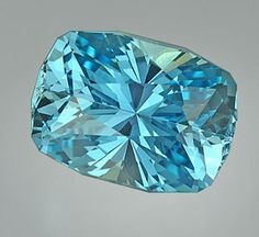 Aquamarine. A member of the beryl family, March's birthstone and, according to lore, brings happiness and wealth to marriage.