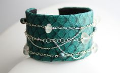 TEAL TILAPIA LEATHER CUFF BRACELET - Tilapia leather cuff with sterling chain lined with white sea glass, freshwater pearls, and Swarovski Crystals hung across.  The inside is lined with a soft faux leather for comfort against the wrist. $65.00