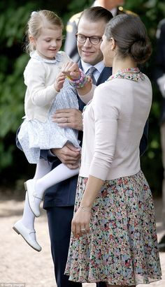 Princess Estelle, Prince Daniel and Crown Princess Victoria share a tender family moment during the day's celebrations