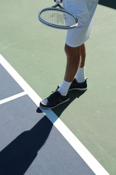 lacoste lt12 . Lacoste tennis racket, sneakers, white outfit - all set to play.
