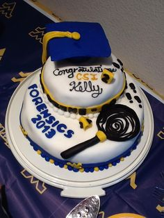 Check out this great cake made for a WVU forensic science grad. Congrats, Kelly!   My mom's cake made WVU Pinterest page!!