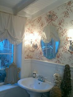 cute curtains and leaning mirror too
