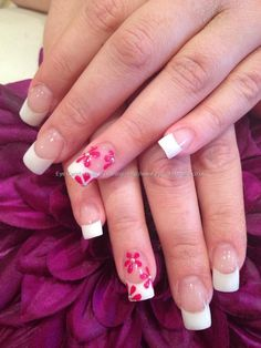 White and clear acrylic nails with pink flower freehand nail art and Swarovski crystals