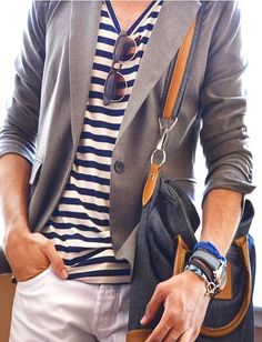 He's so coordinated in this striped shirt, casual jacket and messenger bag. -Lily #streetstyle #fashion