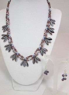 Imagine this woven necklace around your neck as it lays effortlessly, showing off the delicate dagger beads and complicated design of pearls and seed beads.
