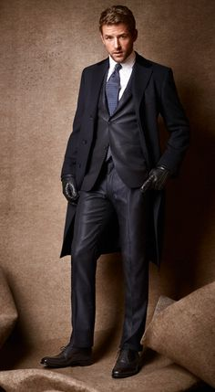 While black is set to make a major return to fashion, we like to put our money on black's always-more-sophisticated sibling, deep, deep navy. Take Ferragamo's cashmere chesterfield, with its flash of velvet at the collar, and Hermès's simple navy suit, with its silk-blend cloth and slightest shine. Dark? Definitely. Gloomy? Never.