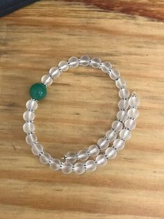Semi clear white beads and green bracelet, summer bracelet, beaded bracelets by designbyafney on Etsy