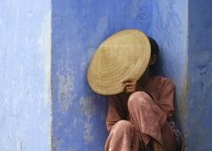 Blue: A Vietnamese woman sleeping in the afternoon in Hoi An.