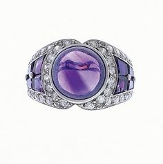 An art deco amethyst and diamond ring, French, circa 1925  The central round cabochon amethyst within a border of single-cut diamonds, between shoulders of tapering calibré-cut amethysts and single-cut diamonds, traces of a maker's mark, numbered, French assay marks, Portuguese import marks