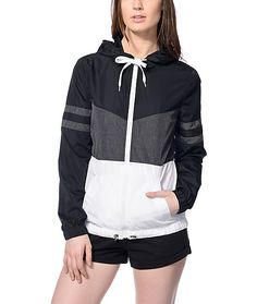 Layer up in style and protect yourself from the wind with this Zuri black, grey and white color block windbreaker by Zine. The elastic drawstring with toggles in the bottom hem will come in handy when you want to either have a more fitted look or you're